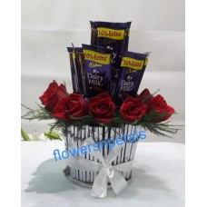 10 red Roses & 5 Dairy Milk Chocolate in a Round basket