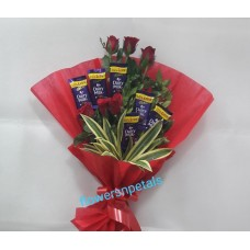 One Sided Hand Bunch with 6 red Roses & 6 Dairy milk chocolate & red Paper Packing